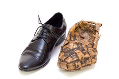 Russian bast shoes and man's shoes Royalty Free Stock Photo