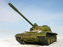 Russian battle tank T-55. Green Russian battle tank T-55 on winter background Royalty Free Stock Image