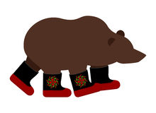 Russian Bear in boots. Russian National animal winter warm shoes.  Royalty Free Stock Photos