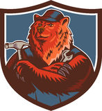 Russian Bear Builder Handyman Crest Woodcut. Illustration of a builder handyman Russian bear or Eurasian brown bear wearing hat arms folded with tools hammer and Royalty Free Stock Image