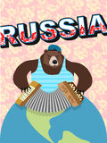 Russian bear. cap with earflaps plays the harmonica Royalty Free Stock Photography
