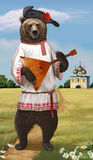 Russian bear plays on the balalaika. Bear in national dress playing a Russian balalaika Stock Photo