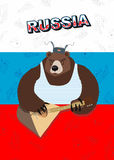 Russian bear plays a musical instrument. The flag of Russia Stock Photo