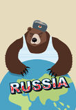 Russian bear soldier in ear flaps and a t-shirt. Keeps paws over Stock Photo