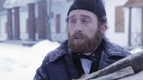 Russian bearded man dressed in 19th century against the background of the winter and antiques stock video footage
