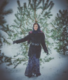 Russian beautiful girl near the Christmas tree in the forest Royalty Free Stock Photos
