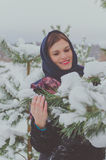 Russian beautiful girl near the Christmas tree in the woods Royalty Free Stock Photography