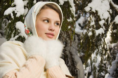 Russian beautiful girl in the winter forest Stock Photo
