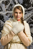 Russian beautiful girl in the winter forest Stock Photos