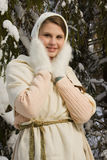 Russian beautiful girl in the winter forest Royalty Free Stock Photo