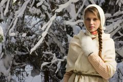 Russian beautiful girl in the winter forest Royalty Free Stock Images