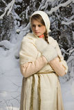 Russian beautiful girl in the winter forest Stock Photography