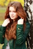 Russian beauty. Beautiful young woman in autumn park Royalty Free Stock Image