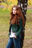 Russian beauty. Beautiful young woman in autumn park Royalty Free Stock Photos