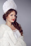 Russian Beauty. Attractive female wearing in kokoshnik. Woman's Royalty Free Stock Image
