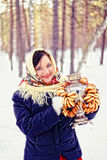 Russian beauty. Russian beauty in the forest in winter with a samovar and dryers Royalty Free Stock Photo