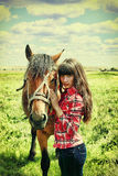 Russian beauty with a horse. Royalty Free Stock Image