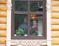 Russian beauty looks through the window royalty free stock image