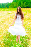 Russian beauty in a rural field with flowers Stock Photos