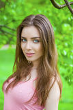 Russian beauty - Young brunette girl at a white birch Stock Image