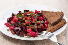 Russian beetroot  salad with bread - vinaigrette, close-up Royalty Free Stock Images
