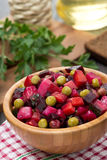 Russian beetroot salad vinaigrette in a bowl, vertical Stock Photo