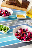 Russian beetroot salad vinaigrette. Two plates of salad beetroot, mustard , green onions and  dark bread Royalty Free Stock Photo