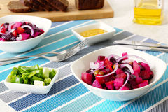 Russian beetroot salad vinaigrette. Two plates of salad beetroot, mustard , green onions and  dark bread Royalty Free Stock Images