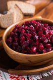 Russian beetroot salad in wooden bowl Stock Photos