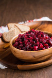 Russian beetroot salad in wooden bowl Stock Images