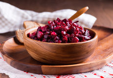 Russian beetroot salad in wooden bowl Royalty Free Stock Photography