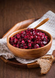 Russian beetroot salad in wooden bowl Stock Photography