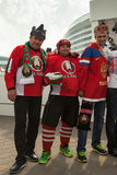 Russian and Belarussian hockey fans in costumes Stock Image