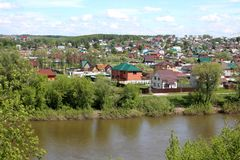 Russian large village on the banks of the river royalty free stock photo