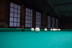 Russian billiard balls position on green game table cloth Royalty Free Stock Photo