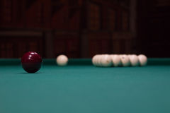 Russian billiard:  black and white balls on green game table Royalty Free Stock Photos
