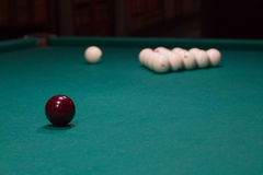 Russian billiard:  black and white balls on green table cloth Stock Images