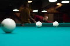 Russian billiard in club: balls on green game table Royalty Free Stock Photos