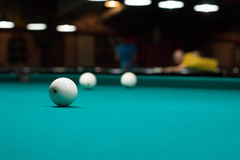 Russian billiard in club: balls on green game table cloth Royalty Free Stock Photos