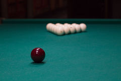 Russian billiard:  red and white balls on green table cloth Stock Image