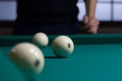 Russian billiards balls on green game table cloth and player Stock Photos
