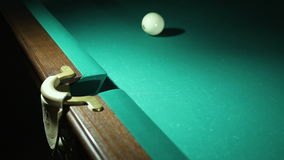 Russian billiards blow cue - successfully. Ball enters the pocket. Close-up stock video footage