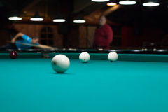 Russian billiards in club: balls on green game table cloth Stock Photo