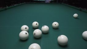 Russian billiards, the first blow, breaking the pyramid. View from above stock video footage