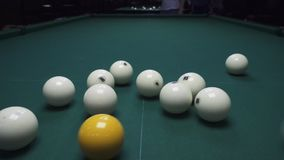 Russian billiards, the first blow, breaking the pyramid. View from above stock footage