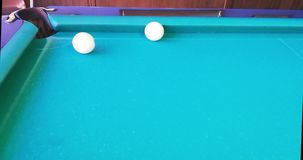Russian billiards. Interesting beats. `Own` clings to the board and falls into the pocket after a collision with a `stranger stock video