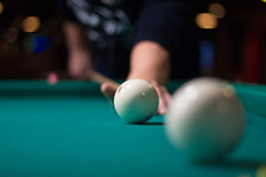 Russian billiards player aims to shoot ball with cue Stock Photo