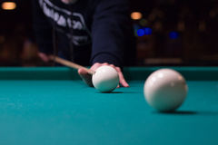 Russian billiards player aims to shoot white ball with cue Royalty Free Stock Photos