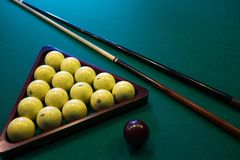 Russian billiards white balls, cue ball, wooden cue on a large table with green cloth Stock Photos