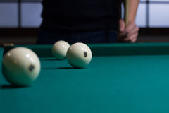 Russian billiards white balls on game table cloth and player Stock Images